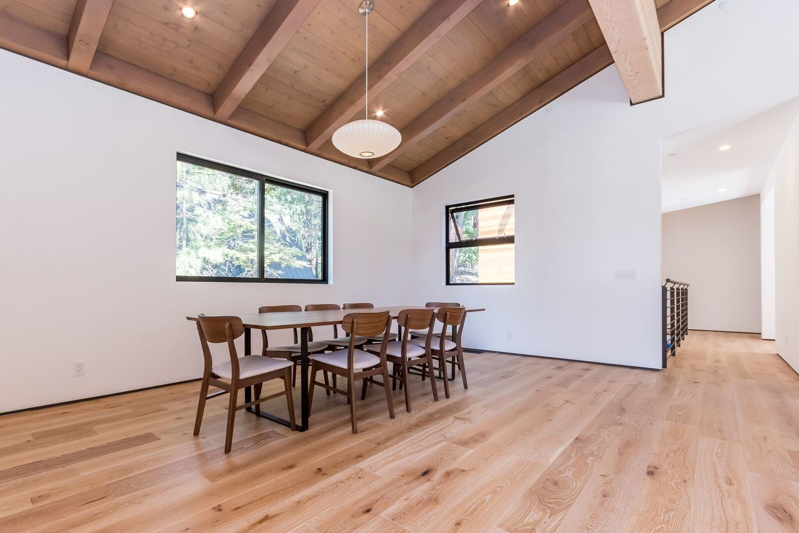 Dining Room, Table, Chair, Medium Hardwood Floor, Standard Layout Fireplace, Ceiling Lighting, and Pendant Lighting A big enough dining space that can serve as a flex area with added seating or lounging.   Mammoth Modern House 1