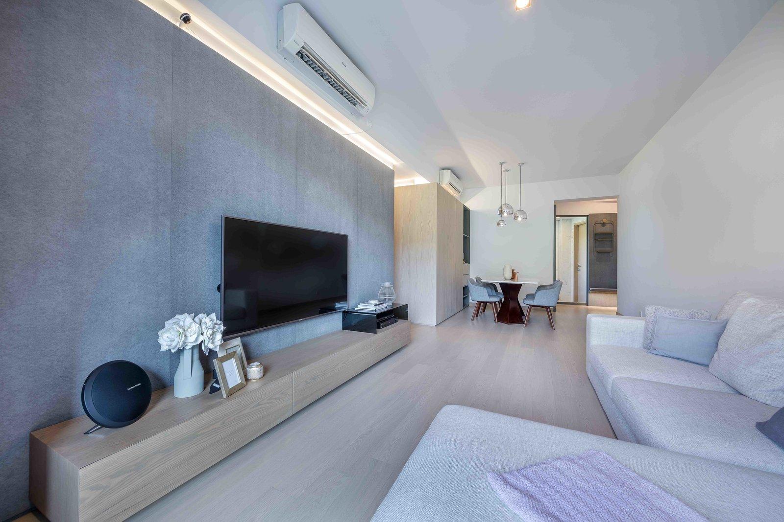 Living Room, Wall Lighting, Sofa, Ceiling Lighting, Floor Lighting, Light Hardwood Floor, and Ottomans www.adj.com.hk  @studioadjective  Dragon's Range Studio Adjective HONG KONG by Studio Adjective Ltd. HK