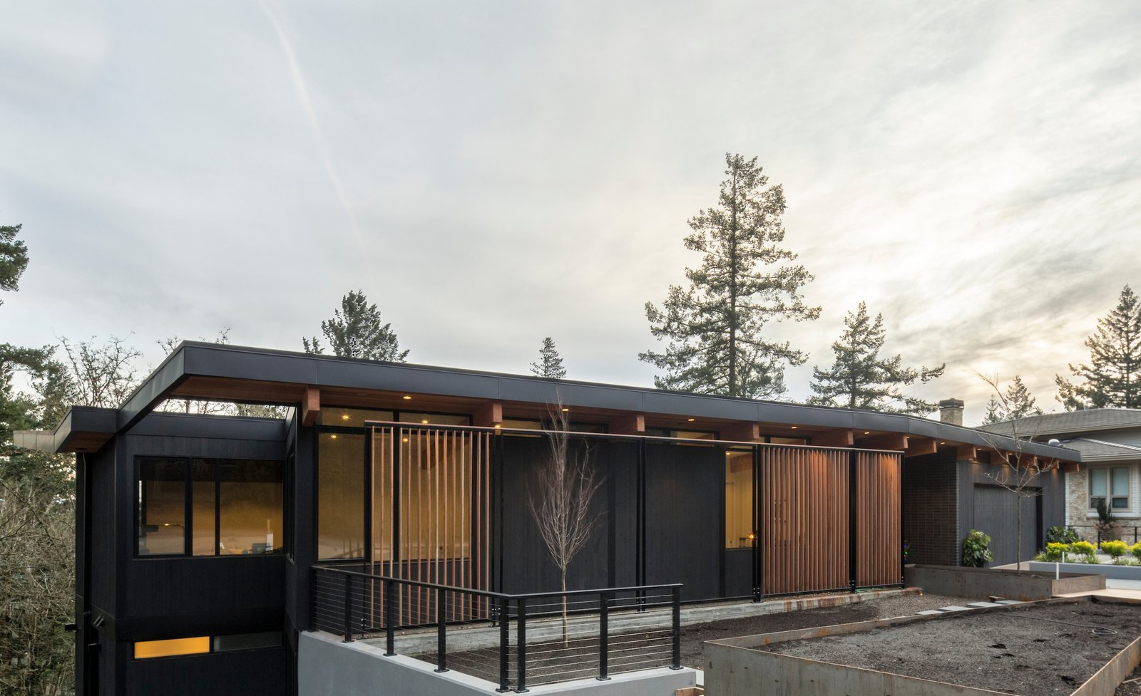 Exterior, Butterfly RoofLine, House Building Type, Wood Siding Material, and Brick Siding Material Facade  The Greenhills House