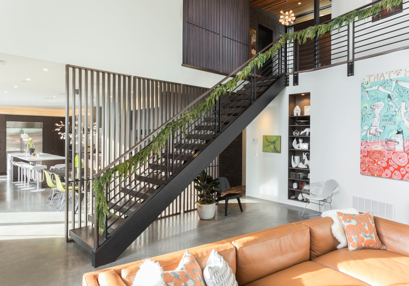 Living Room, Bookcase, Accent Lighting, Pendant Lighting, Ceiling Lighting, Recessed Lighting, Chair, Concrete Floor, and Sectional Entry stair  The Greenhills House