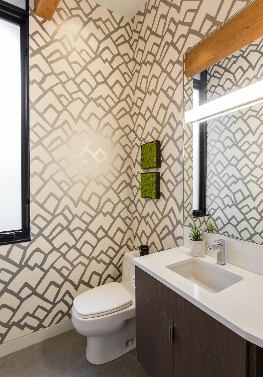 Bath Room, Ceiling Lighting, Wall Lighting, Engineered Quartz Counter, Undermount Sink, Ceramic Tile Wall, One Piece Toilet, Porcelain Tile Floor, Recessed Lighting, Subway Tile Wall, and Accent Lighting Upstairs powder room  The Greenhills House