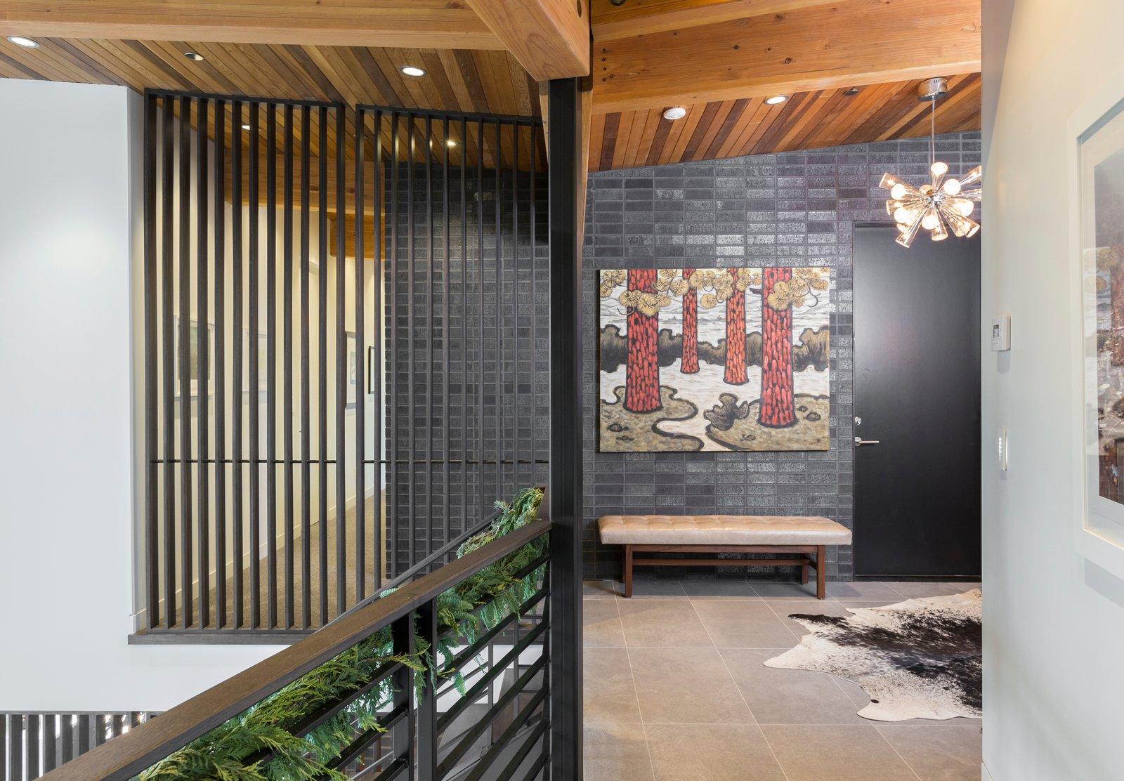 Hallway, Porcelain Tile Floor, Rug Floor, and Carpet Floor Upstairs main entry  The Greenhills House