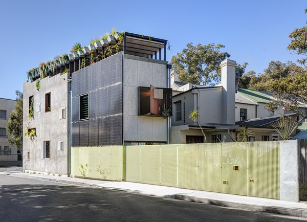 The side elevation shows the master bedroom's rear window and solar-panel facade.