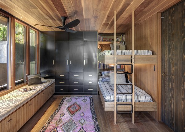 The children's bedroom has bespoke joinery designed to help the children interface with the environmental workings of the house.