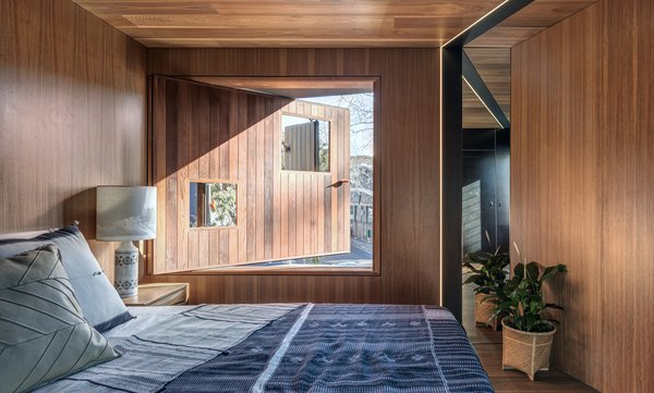 The master bedroom features a pivot window with smaller window openings for privacy.
