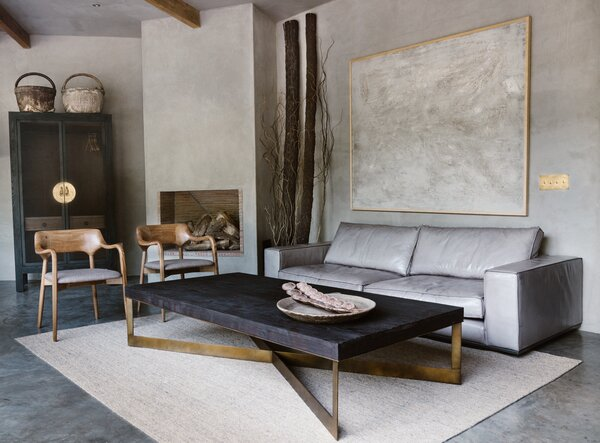 Ashoka enlisted the services of the San Miguel de Allende–based interior studio NAMUH in selecting pieces for the interiors. The living room features a soft gray buffalo leather sofa, a reclaimed oak table with metal accents, and an Indian jute rug.