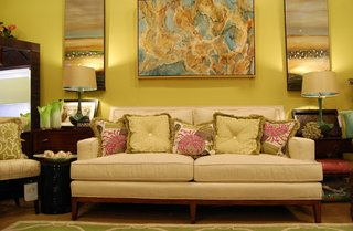 Chesterfiled Couch With Accents and Beige Carpet and Rug