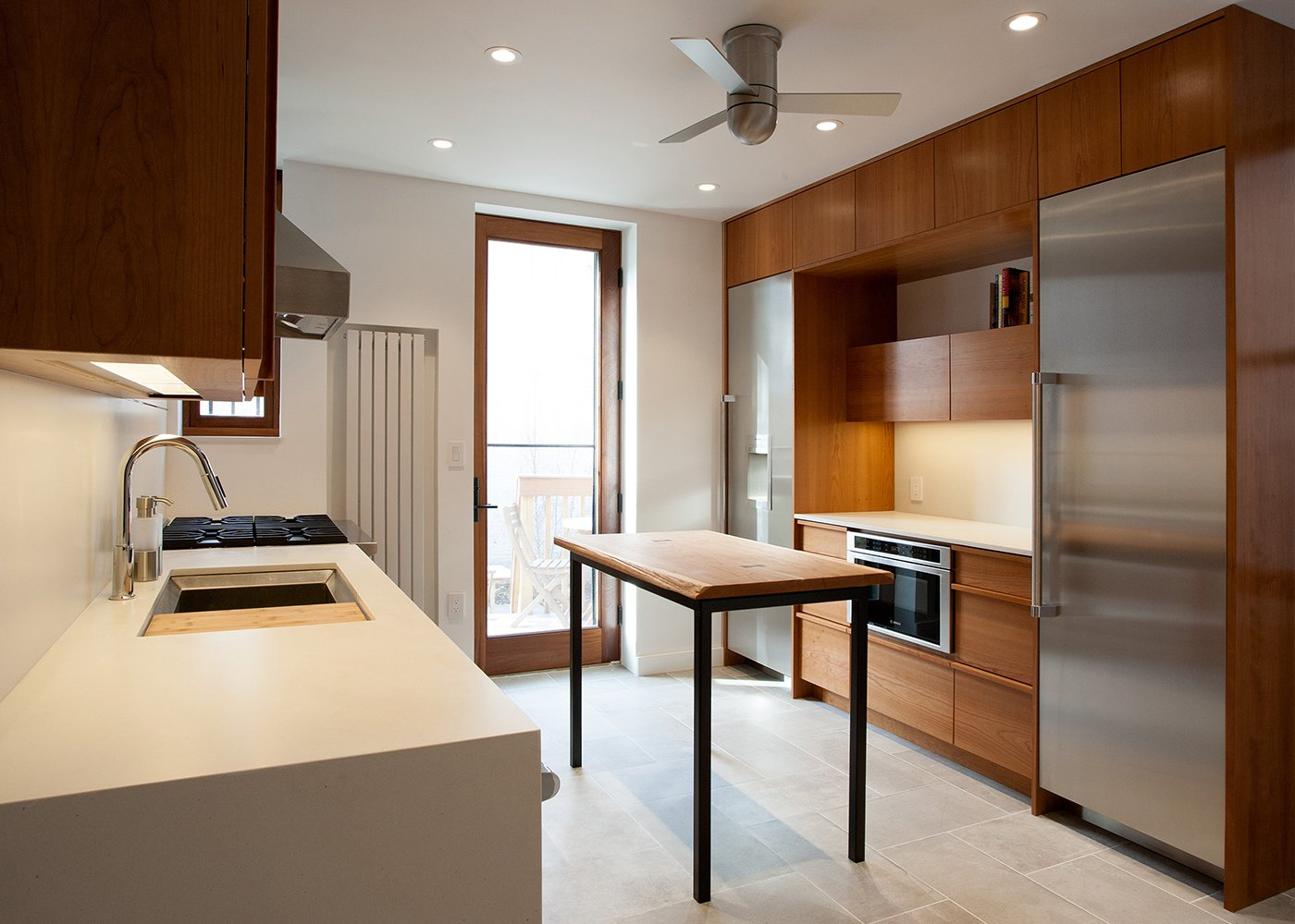 Kitchen, Engineered Quartz, Wood, Porcelain Tile, Stone Slab, Recessed, Refrigerator, and Drop In Kitchen  Best Kitchen Drop In Porcelain Tile Photos from Stuyvesant Townhouse
