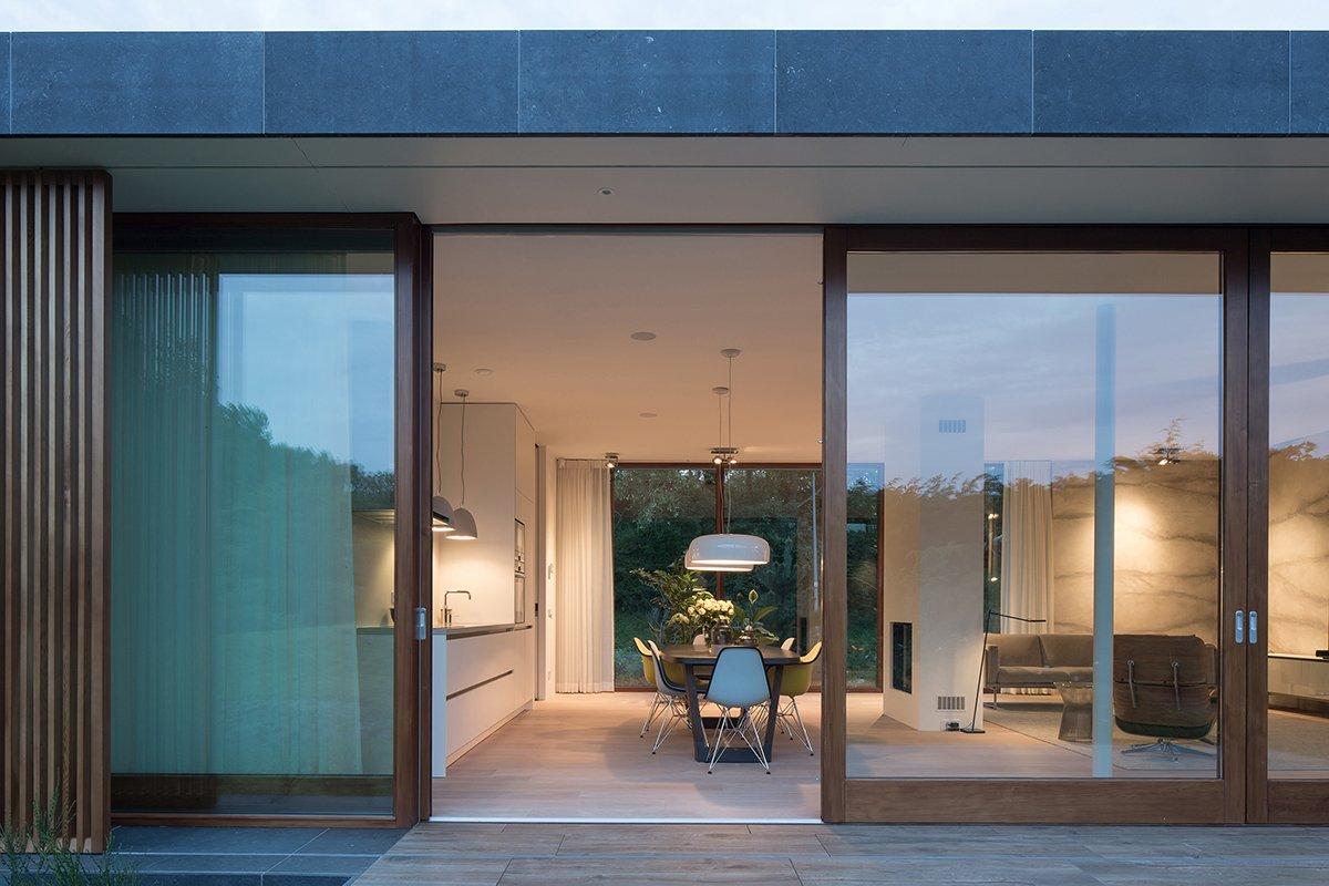 Doors, Exterior, Wood, and Sliding Door Type Villa H | sliding doors blend in- and outdoor space  Photos from Villa H by BERG + KLEIN