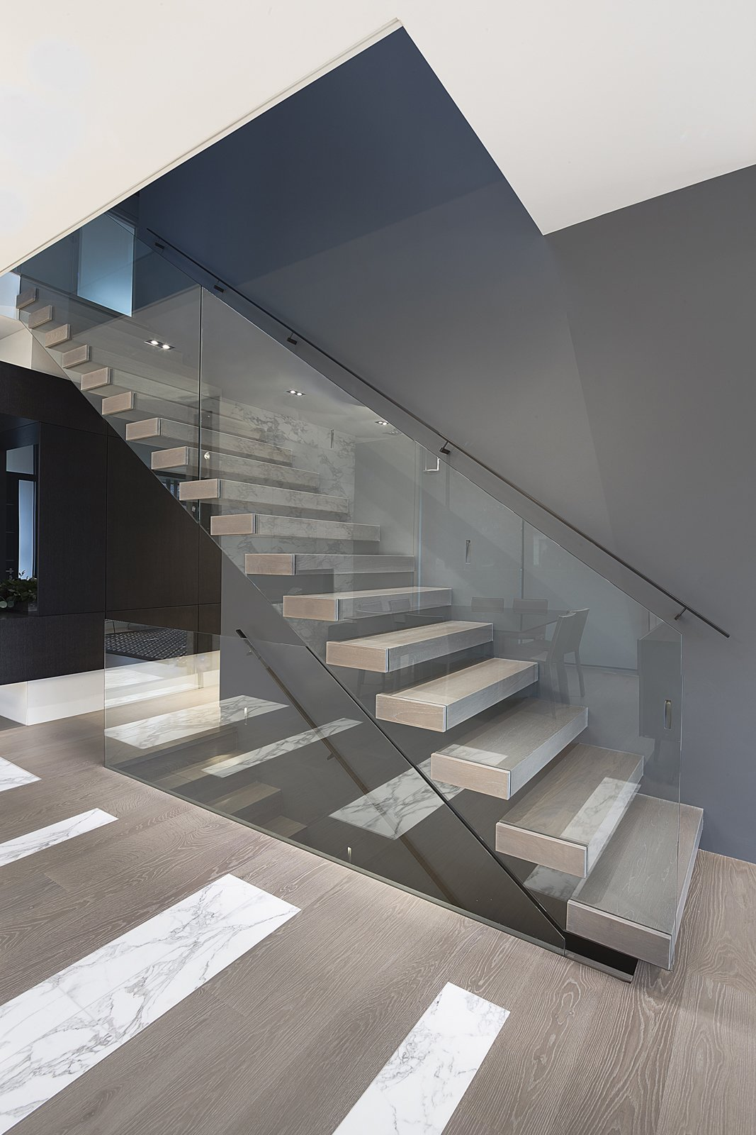 Staircase, Glass Railing, and Wood Tread Sculptural Staircase  IN House