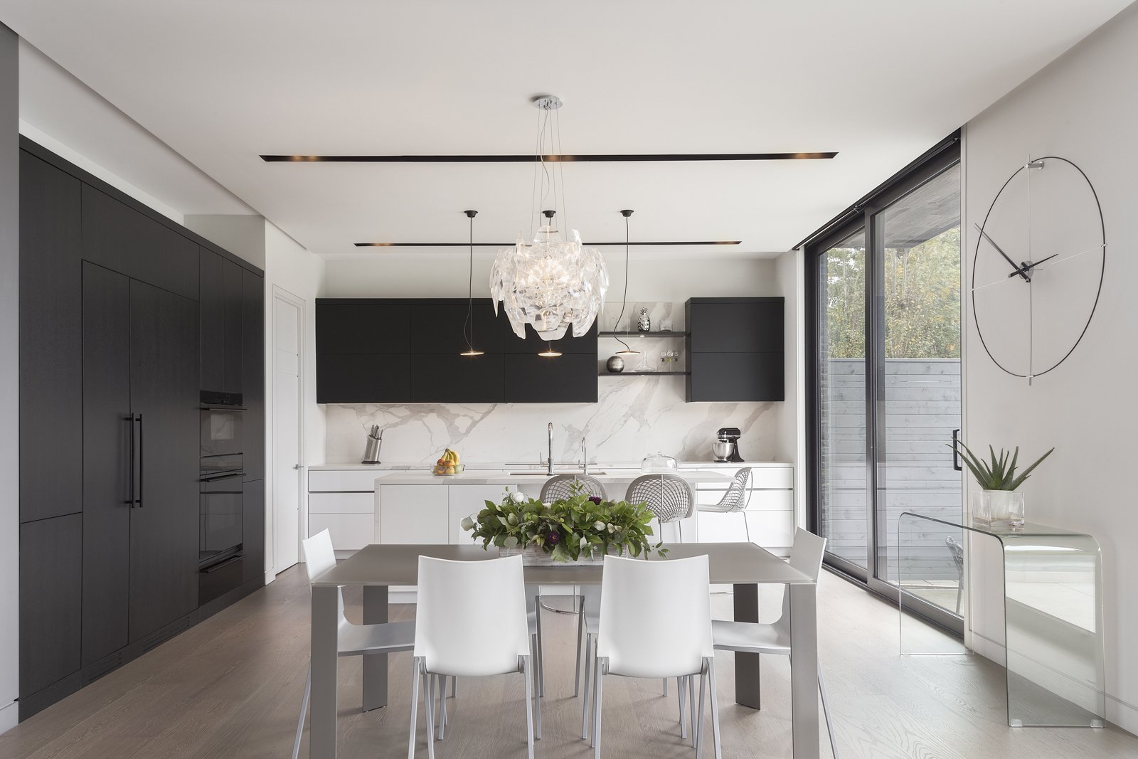 Kitchen, Light Hardwood Floor, Pendant Lighting, Drop In Sink, and Wood Cabinet Kitchen  IN House