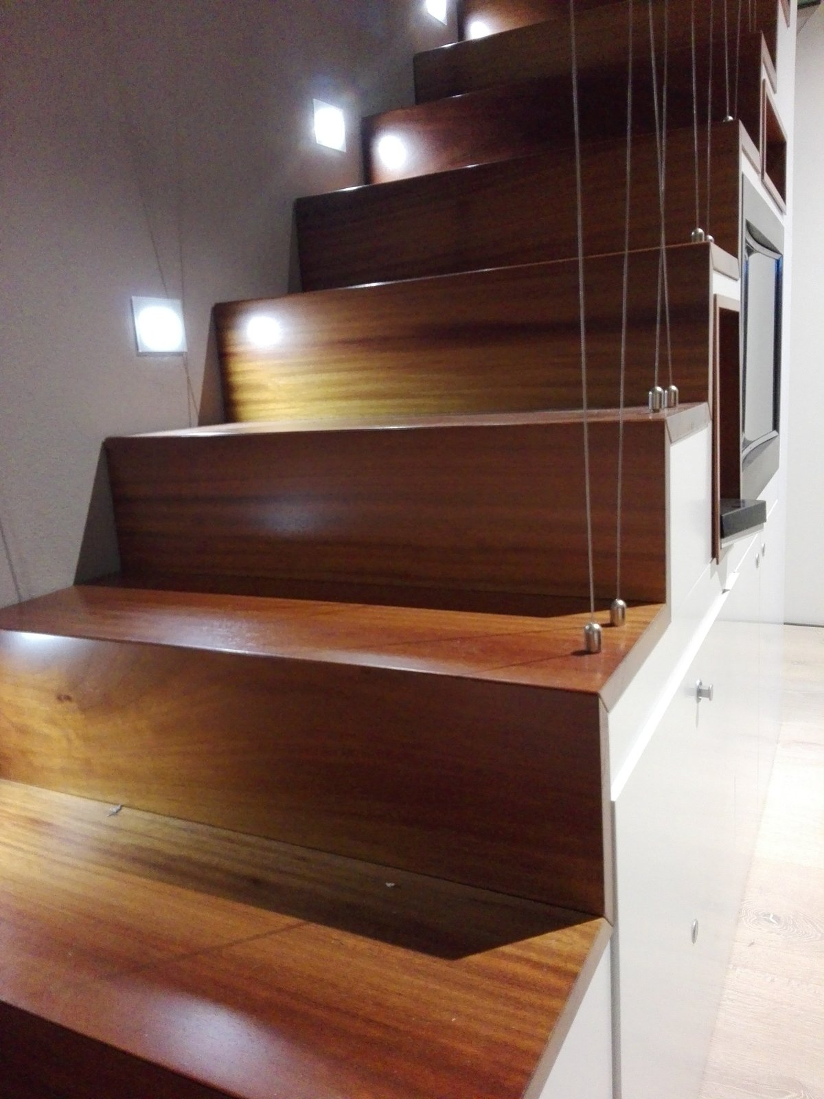 Staircase, Cable Railing, and Wood Tread wooden staircase to the mnaster closet, detail of the handrail made in stainless steel cables  CAFElab architects turns an old farmhouse into a luxury residence in Rome