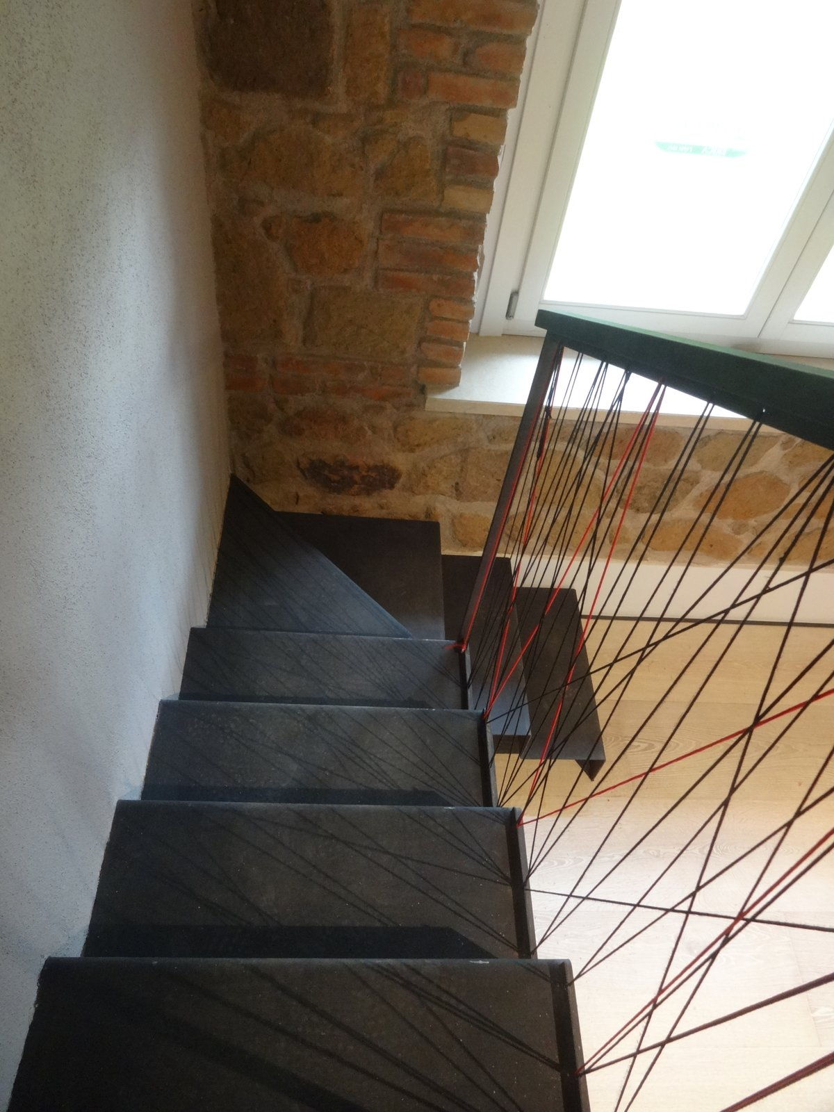 Staircase, Metal Tread, Metal Railing, and Cable Railing detail of the staicase in bent sheet metal and cordura  CAFElab architects turns an old farmhouse into a luxury residence in Rome