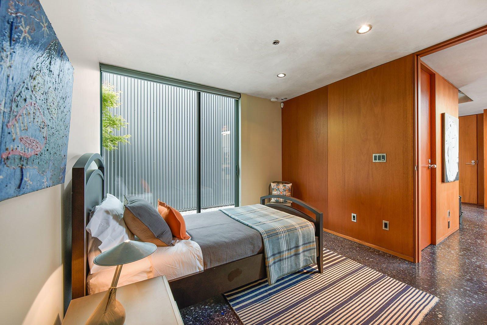 Bedroom, Concrete Floor, and Ceiling Lighting Level 1 teen bedroom  The Rempel Temple