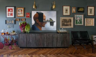 "GALLERY WALL Color Farrow & Ball: ""Downpipe"" Collection of original and vintage art   Large Art: Centerpiece   Bird #1 by Robert Peluce  Chairs: A vintage late 1930's double theater seating by The Heywood Wakefield Co. Garret & Garage Studio"