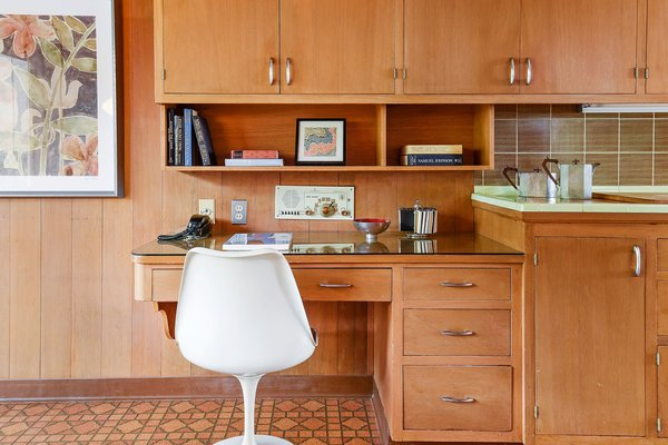 Kitchen, Tile, Wood, Vinyl, Refrigerator, Cooktops, and Wall Oven Quintessential mid-century built-in desk in the kitchen  Best Kitchen Vinyl Wall Oven Photos from Vintage Hollywood in the Berkeley Hills