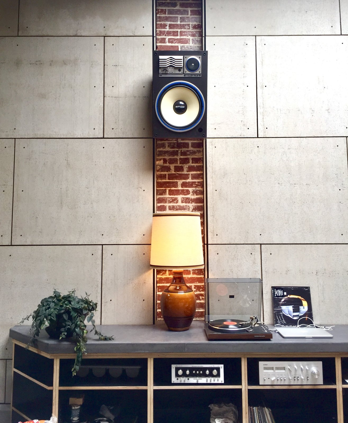 Storage Room and Cabinet Storage Type Exposed brick and a 1970s sound system add to Proud Mary's comfy vibe.  Photo 6 of 8 in An Australian Cafe Filled With Handcrafted Details Comes to Portland, Oregon