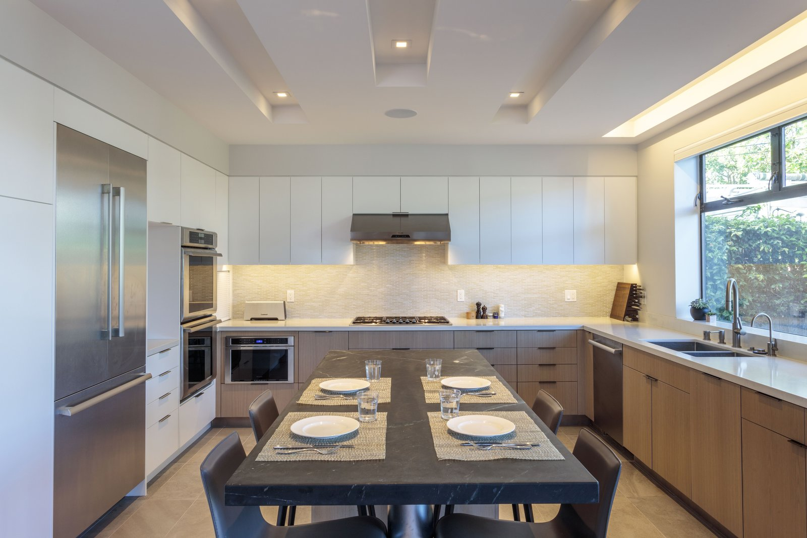 Kitchen, Stone Counter, Engineered Quartz Counter, White Cabinet, Wood Cabinet, Porcelain Tile Floor, Ceramic Tile Backsplashe, Recessed Lighting, Refrigerator, Wall Oven, Cooktops, Range Hood, Dishwasher, Microwave, and Undermount Sink kitchen  Legal House