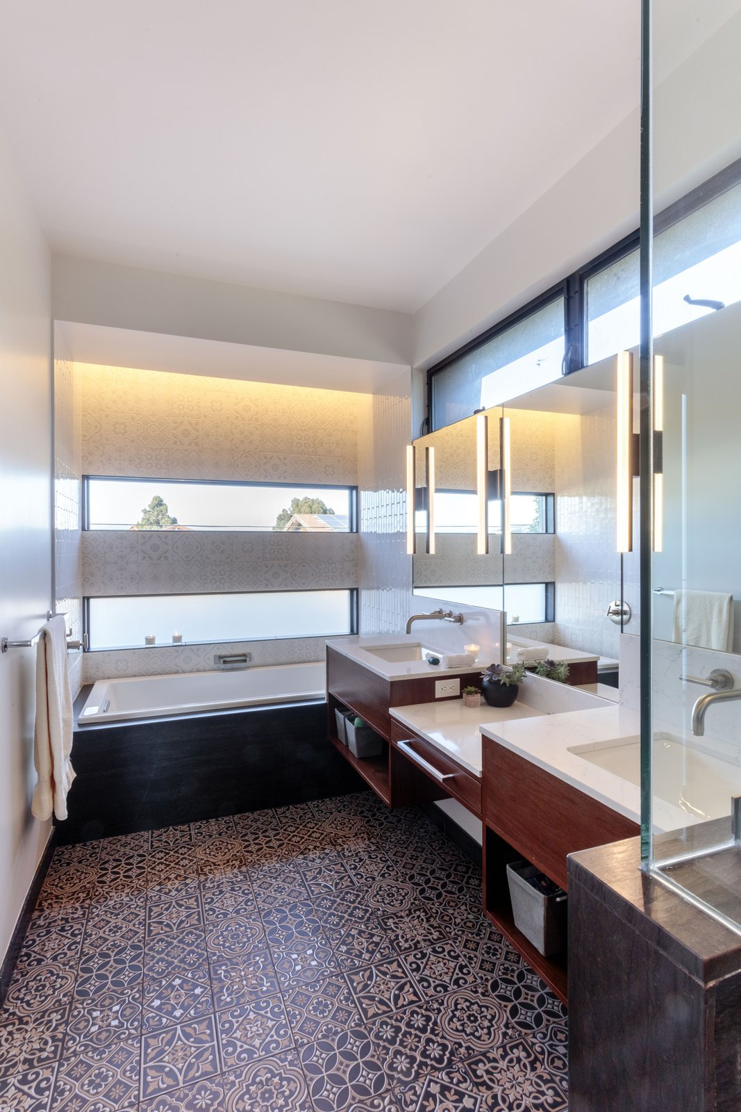 Bath Room, Ceramic Tile Floor, Engineered Quartz Counter, Undermount Sink, Drop In Tub, Enclosed Shower, Accent Lighting, and Wall Lighting master bath  Legal House
