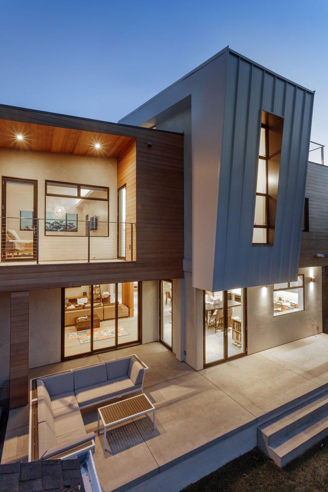Exterior, House Building Type, Stucco Siding Material, Wood Siding Material, and Metal Siding Material back patio  Legal House