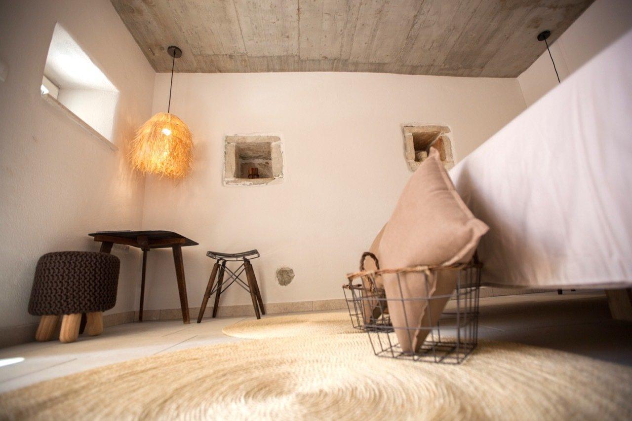 Bedroom, Bed, Chair, Wardrobe, Night Stands, Pendant Lighting, Wall Lighting, and Medium Hardwood Floor Room 1  Villa No24