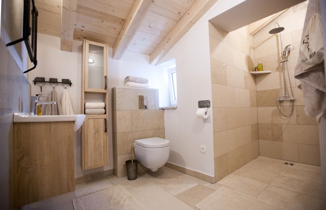 Bath Room, Limestone Floor, Drop In Sink, Open Shower, Wall Lighting, Stone Tile Wall, One Piece Toilet, and Stone Counter Bathroom 2  Villa No24