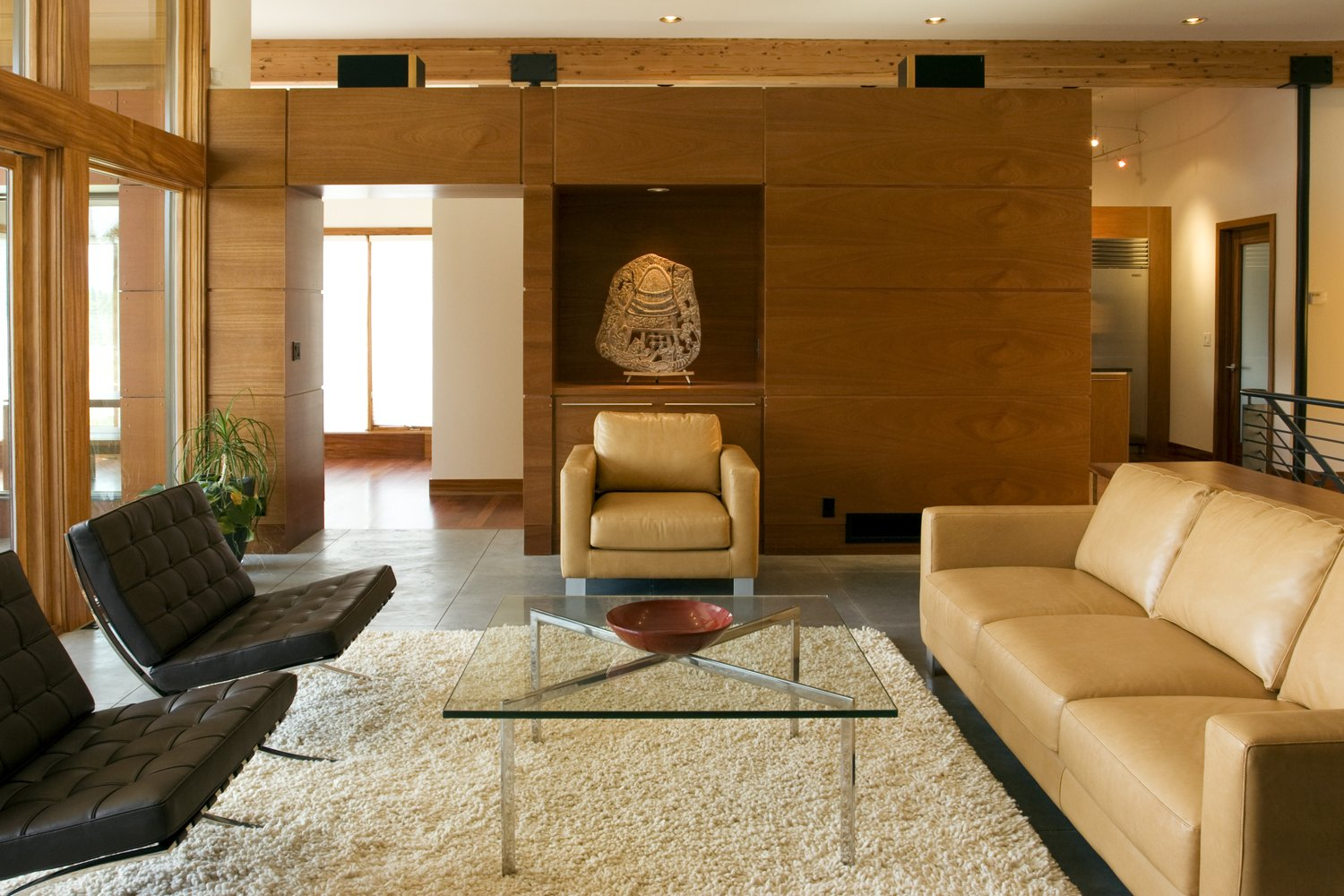 Living Room, Concrete Floor, Coffee Tables, Chair, and Gas Burning Fireplace Living room  High Desert Pavillion