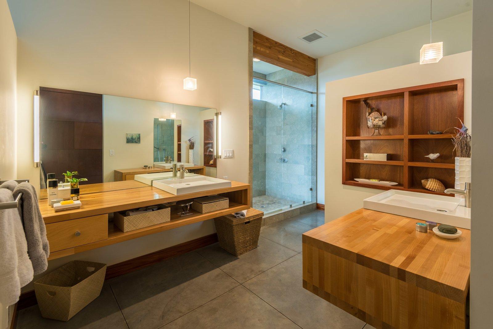 Bath Room, Wood Counter, Concrete Floor, Vessel Sink, Pendant Lighting, Stone Tile Wall, Enclosed Shower, Full Shower, and Corner Shower Master Bath  High Desert Pavillion