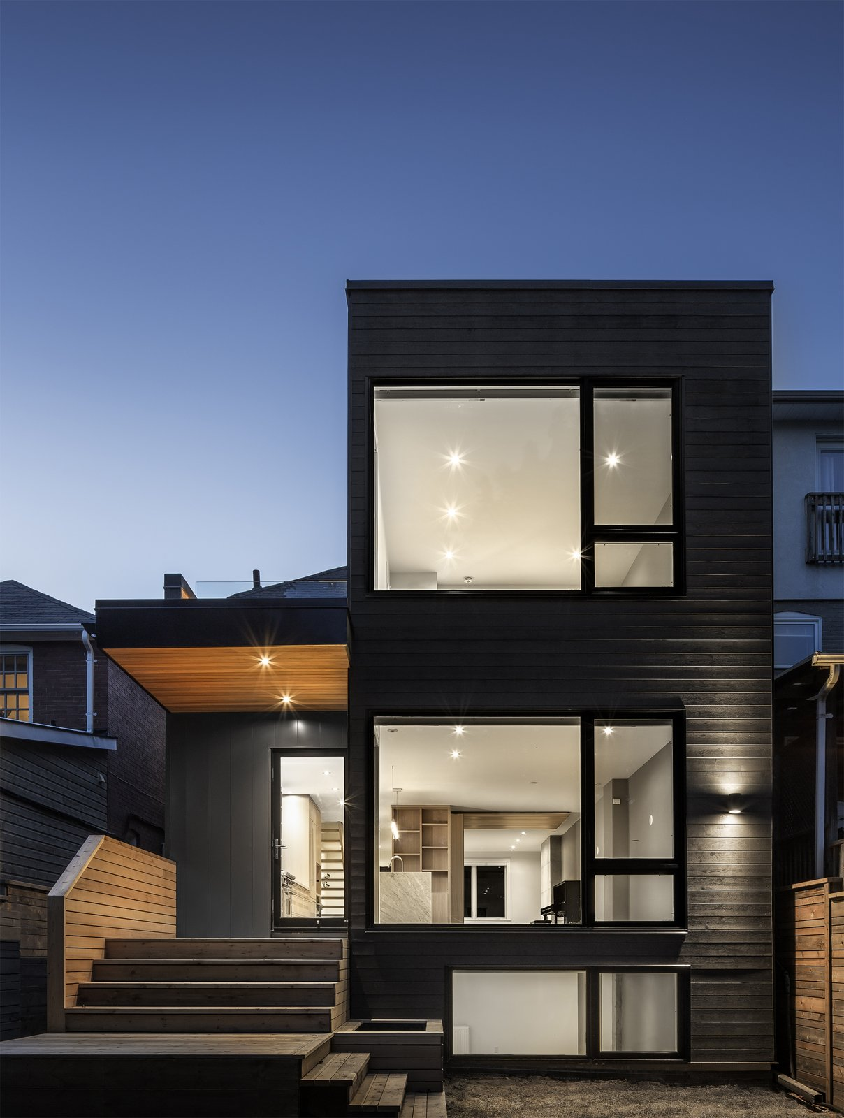 Exterior, House Building Type, Flat RoofLine, Metal Siding Material, Glass Siding Material, and Wood Siding Material Dusk view of addition from garden  North Toronto Addition by Asquith Architecture