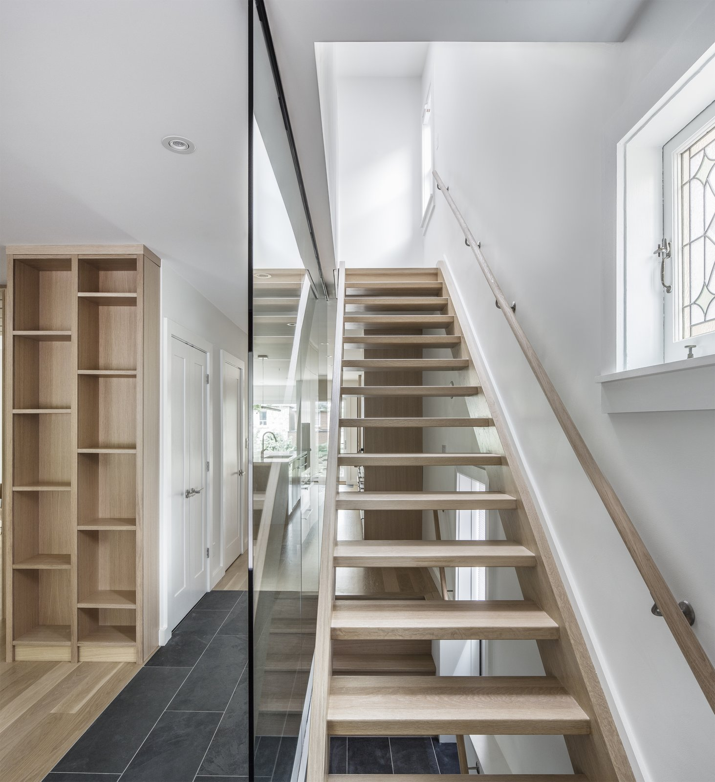 Staircase, Glass Railing, Wood Tread, and Wood Railing View of Staircase  North Toronto Addition by Asquith Architecture