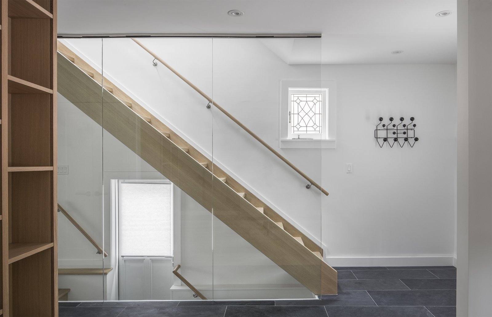 Staircase, Wood Tread, Wood Railing, and Glass Railing View of Staircase  North Toronto Addition by Asquith Architecture