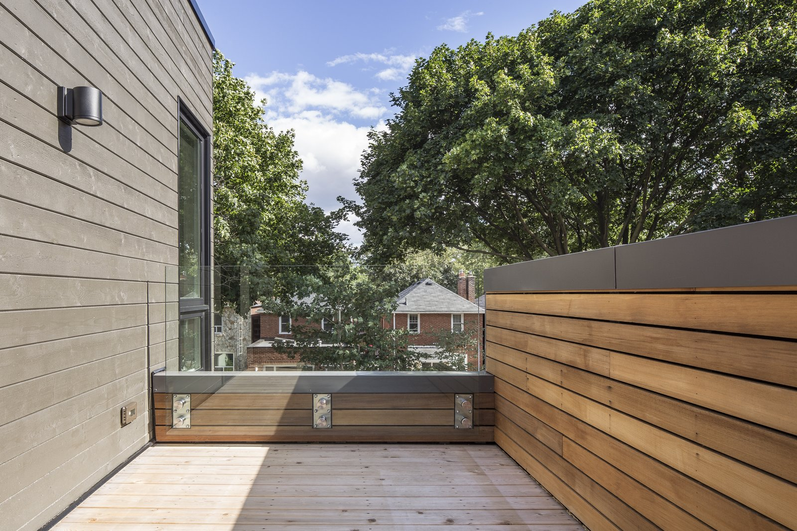 Outdoor, Rooftop, Small Patio, Porch, Deck, Horizontal Fences, Wall, Wood Fences, Wall, Decking Patio, Porch, Deck, and Trees Second Floor Balcony  North Toronto Addition by Asquith Architecture