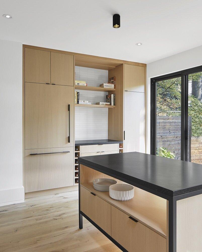 Kitchen, Granite Counter, Wood Cabinet, and Light Hardwood Floor Black accents  Toronto Beach Renovation