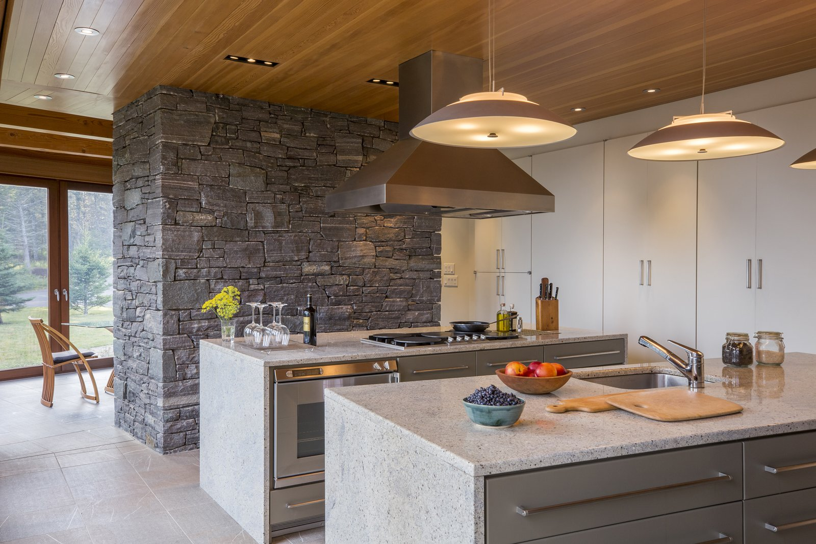 Kitchen, Granite, Colorful, Limestone, Recessed, Ceiling, Refrigerator, Wall Oven, Pendant, Cooktops, Range Hood, Dishwasher, and Undermount Kitchen, looking towards the dining room  Best Kitchen Pendant Dishwasher Range Hood Limestone Recessed Refrigerator Photos from Deep Cove House