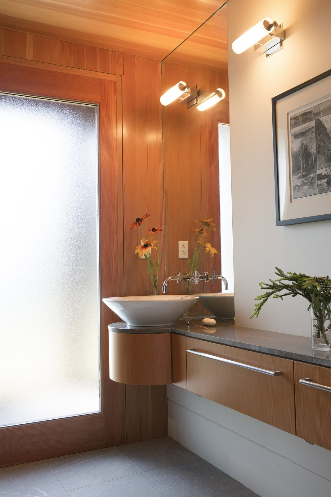 Bath Room, Granite Counter, Limestone Floor, Vessel Sink, Open Shower, Wall Lighting, Ceiling Lighting, and Two Piece Toilet Powder room  Deep Cove House by Elliott + Elliott Architecture
