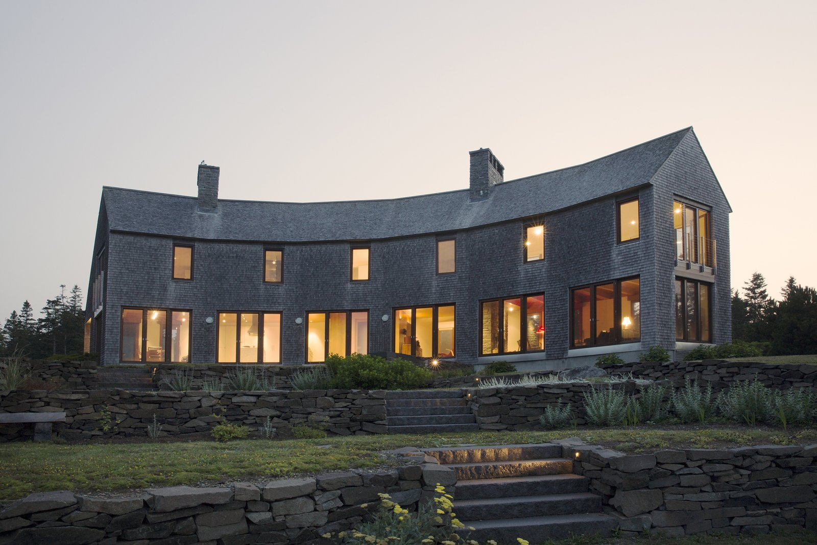 Exterior, Shingles Roof Material, House Building Type, Wood Siding Material, and Gable RoofLine Southwest faceted facade from garden  Deep Cove House by Elliott + Elliott Architecture