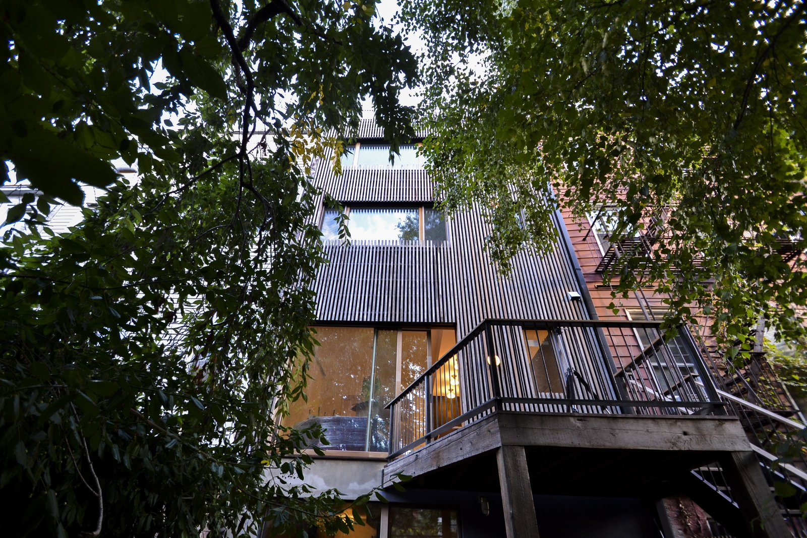 Exterior, House, Tile, Wood, Green, and Flat Exterior rear facade with reclaimed Cony Island boardwalk  Best Exterior Tile Wood Green Photos from Clifton Residence