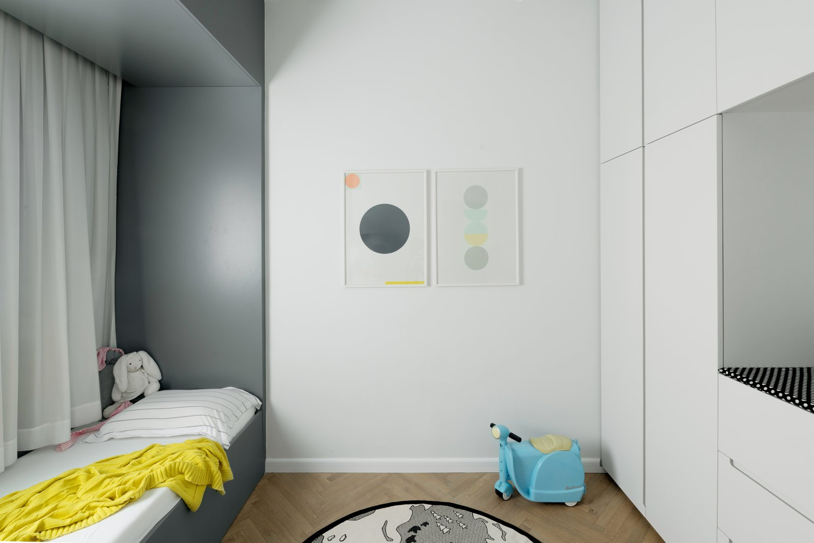 Kids Room, Bedroom Room Type, Bed, Dresser, Bookcase, Bunks, Medium Hardwood Floor, Toddler Age, Storage, Neutral Gender, Boy Gender, and Girl Gender kid's room- we placed the children's toys in the family room, and we costumed designed a closet that has a built-in diaper-changing area in the middle.  Colorfull in the white city by Lital Ophir I Interior Design