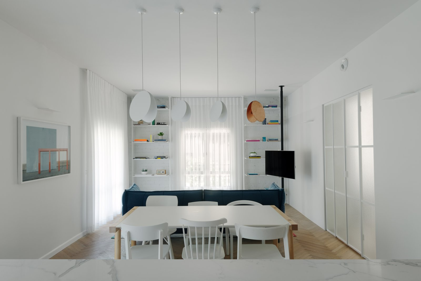 Dining Room, Storage, Table, Chair, Ceiling Lighting, Wall Lighting, Pendant Lighting, and Medium Hardwood Floor living room  Colorfull in the white city by Lital Ophir I Interior Design
