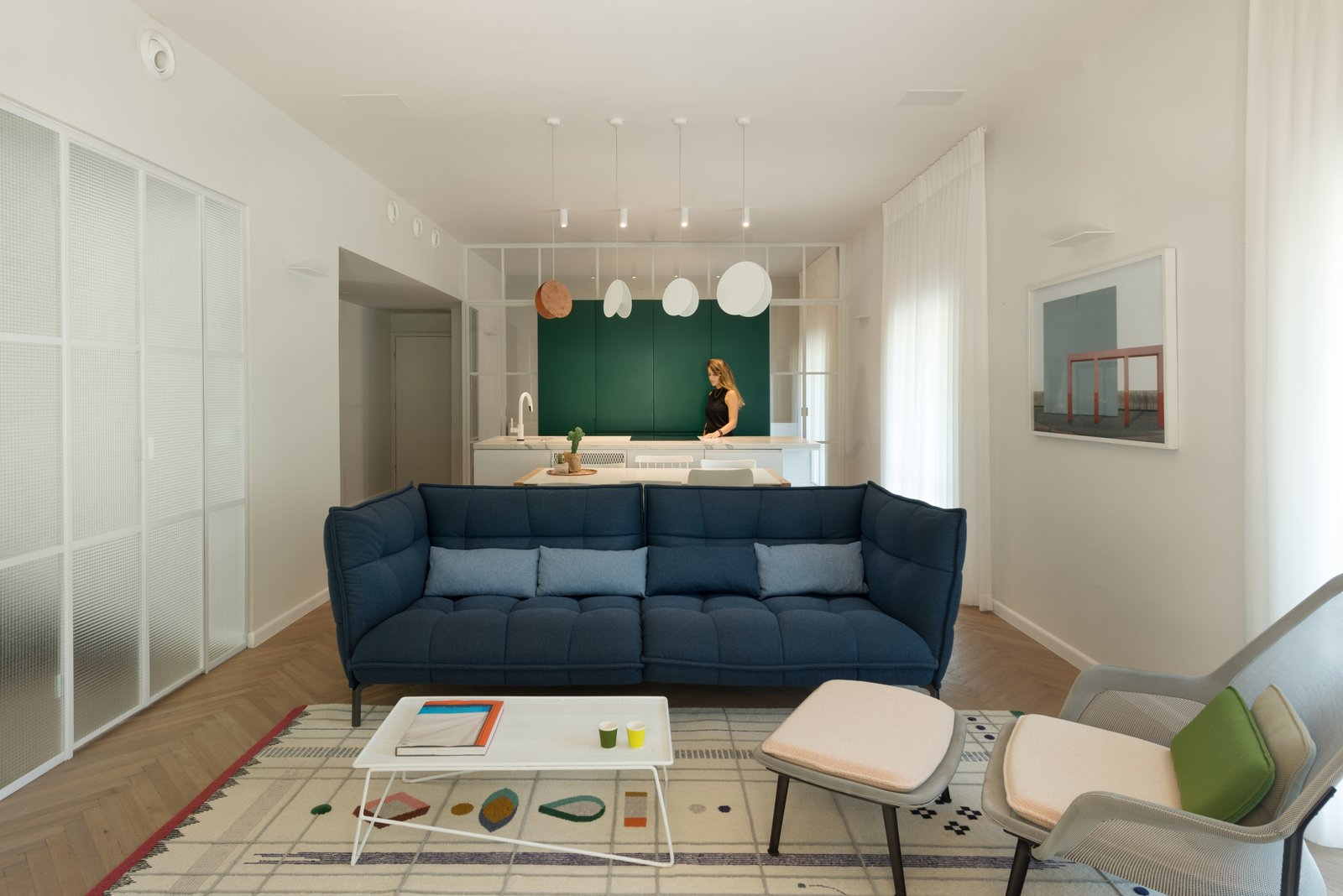 Living Room, Sofa, Chair, Coffee Tables, Bookcase, Ceiling Lighting, Pendant Lighting, Wall Lighting, and Medium Hardwood Floor living room  Best Photos from Colorfull in the white city