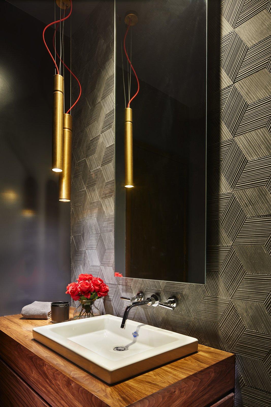 Bath Room, Vessel Sink, Wood Counter, and Pendant Lighting Powder bathroom.  Bent Tree Residence