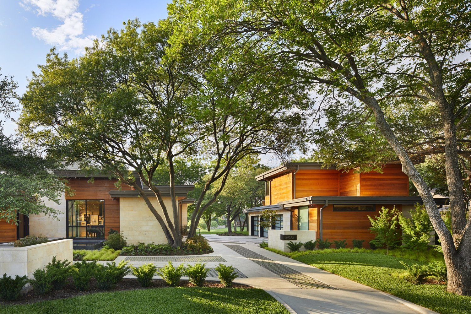 Exterior, Metal Roof Material, House Building Type, Wood Siding Material, and Flat RoofLine Front view of home and guest house/garage.  Bent Tree Residence