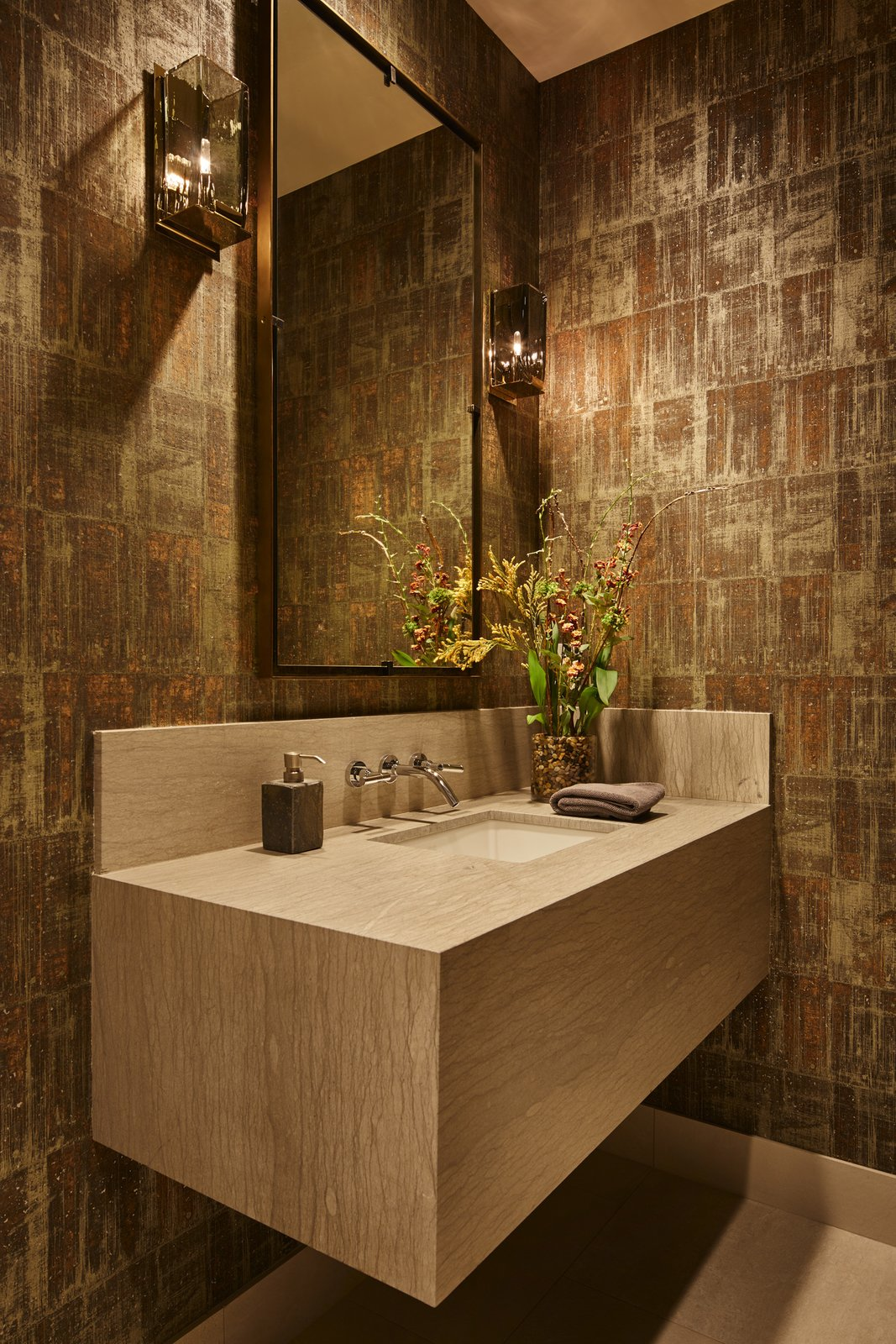 Bath Room, Porcelain Tile Floor, Undermount Sink, Wall Lighting, and Marble Counter Guest bathroom.  Bent Tree Residence