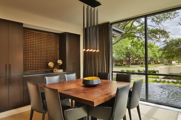 Formal dining room with view of entry water feature.