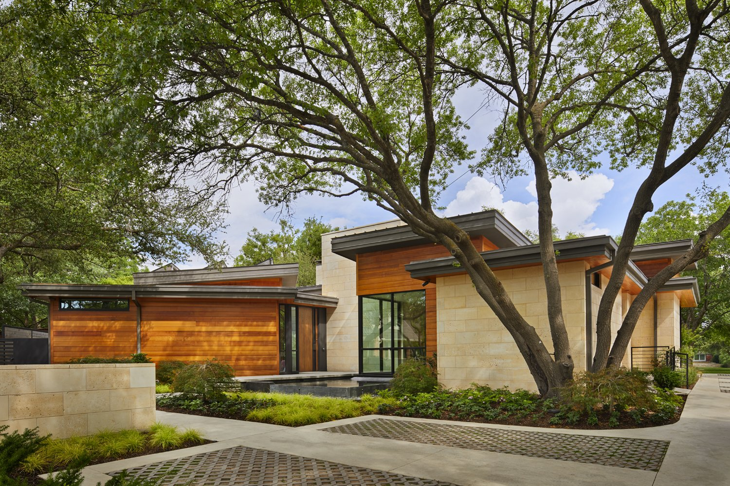 Exterior, House Building Type, Flat RoofLine, Wood Siding Material, and Metal Roof Material Front view of main home.  Bent Tree Residence