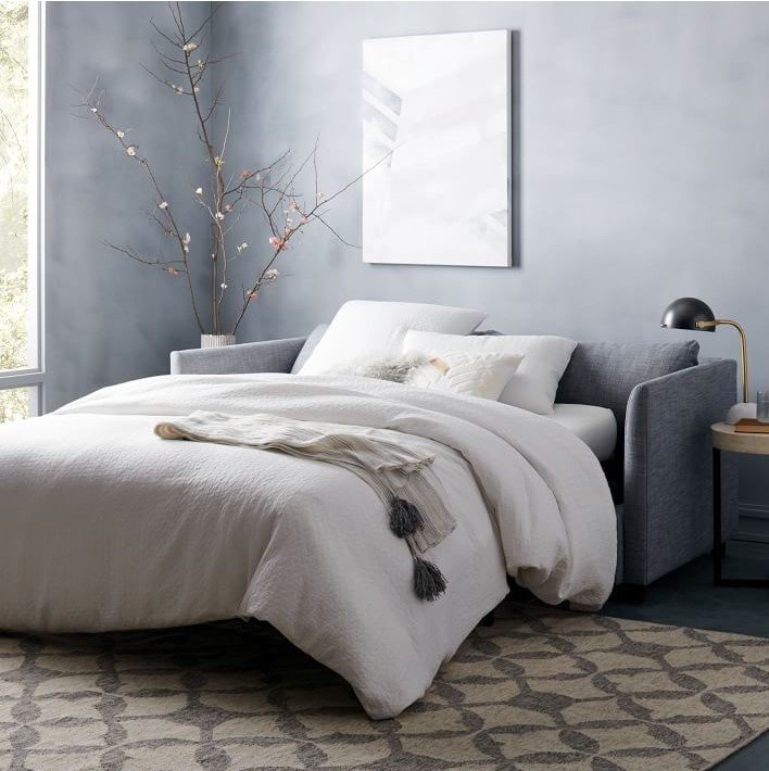 Bedroom, Rug Floor, Bed, Night Stands, Table Lighting, and Storage Shelter Queen Sleeper Sofa from We  Photo 6 of 11 in Sofa Bed Versus Wall Bed: What's Best For Your Small Space?
