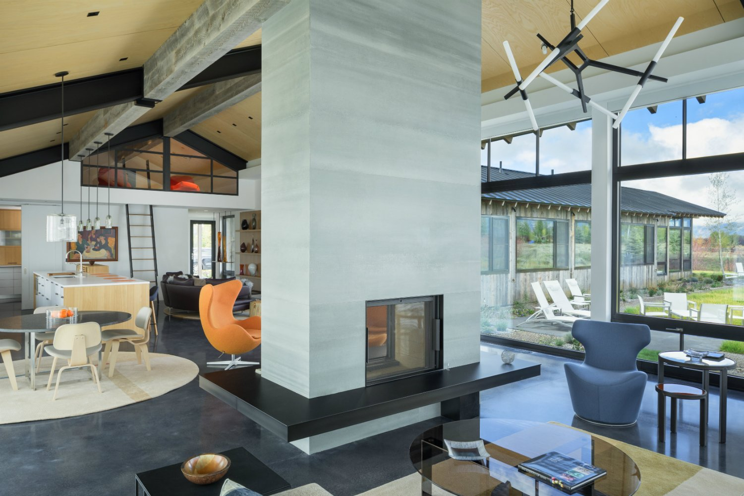 Living, Concrete, Two-Sided, Ceiling, Coffee Tables, and Gas Burning Great Room  Best Living Two-Sided Ceiling Photos from The Landing