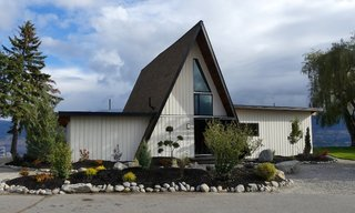 The result of a year-long renovation, this modified A-frame overlooks the fantastic hills of Okanagan's wine country.
