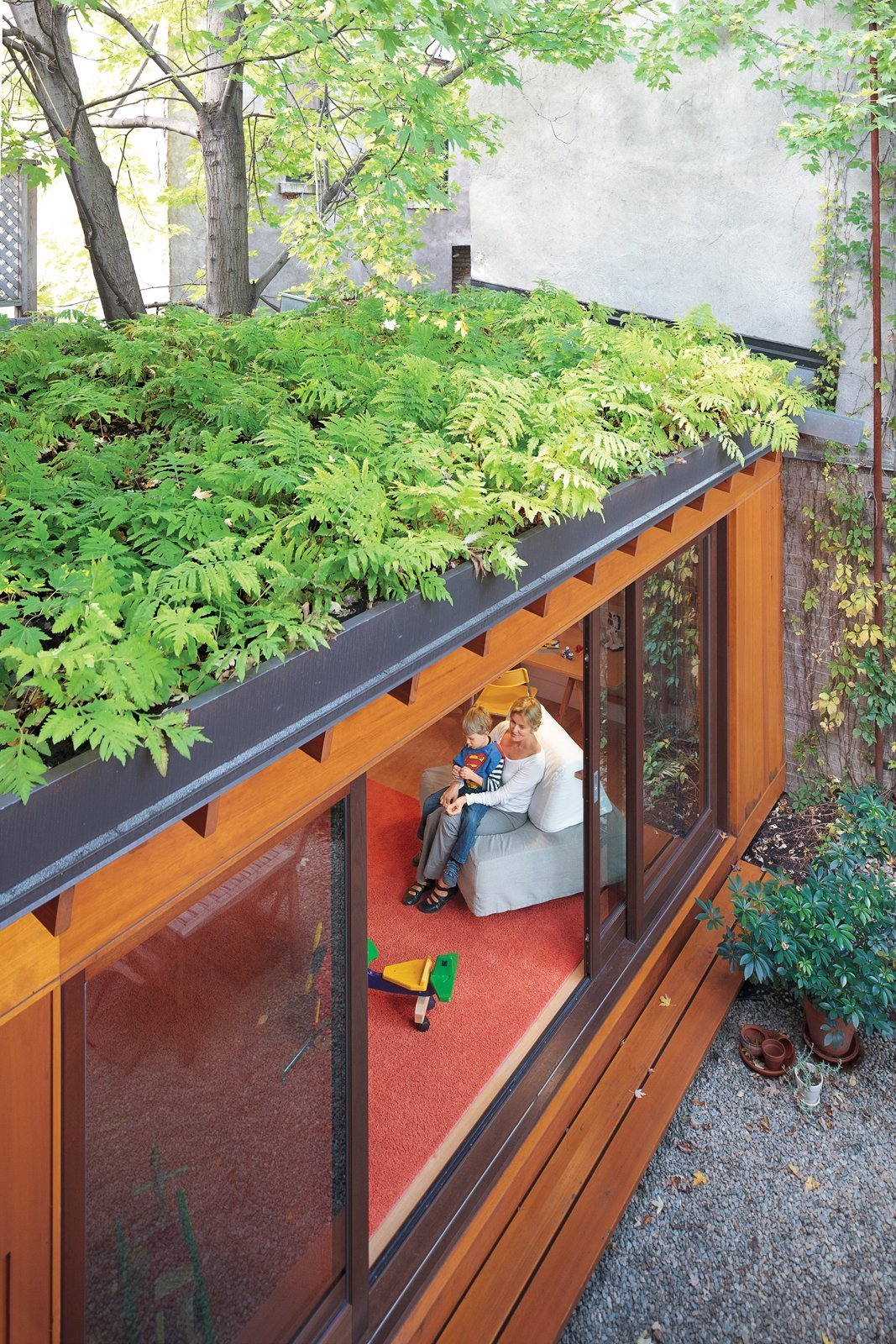 Exterior, Green Roof Material, House Building Type, Flat RoofLine, and Wood Siding Material Green roof in Montreal  Photo 3 of 7 in 4 Easy Steps to Creating Your Own DIY Green Roof