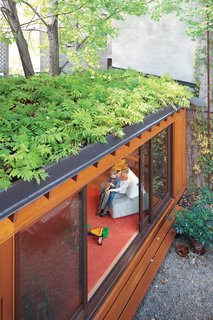 At Paul Bernier and Joëlle Thibault's home in Montreal, a green roof helps make up for lost garden space and creates a beautiful leafy view from the second and third floors. In summer, when the sliding doors are left wide open, indoor and outdoor spaces blend together.